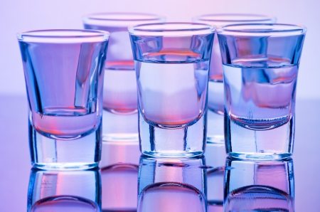 drink shot glasses with reflection in red and blue photo