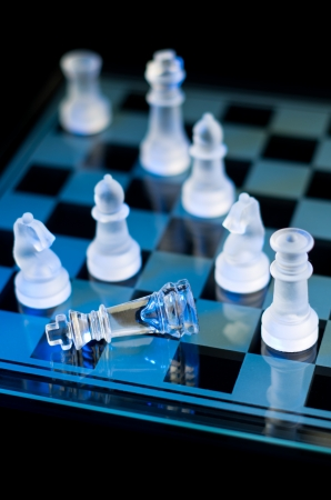 chess board: checkmate with glass chess in blue light Stock Photo