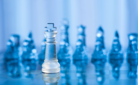 blue glass chess with shallow depth of gield photo