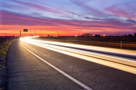 streaks: long exposure of traffic at sunset wuth light streaks Stock Photo