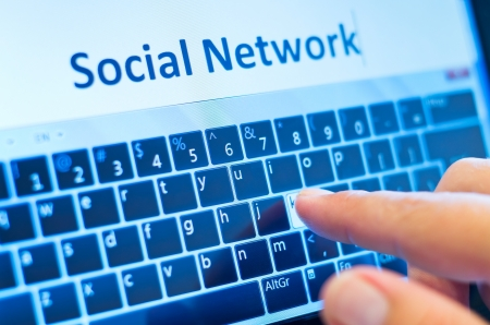title hands: social network on touch-screen tablet-pc with finger on virtual keyboard
