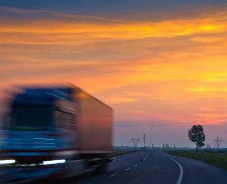 lowkey: lowkey long exposure of truck at sunrise