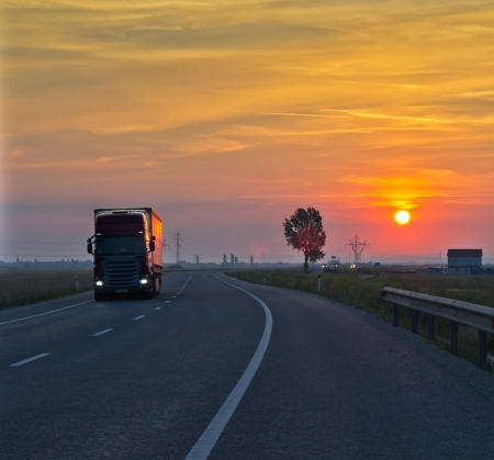 long exposure of truck at sunset photo