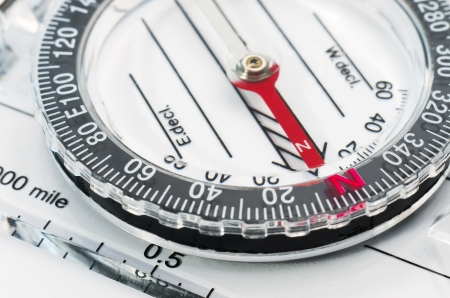 orienting: closeup of compass indicating north Stock Photo