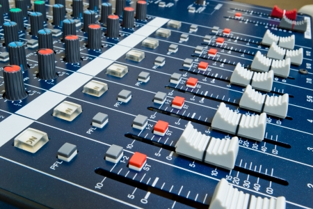 professional audio mixer with shallow depth of field photo