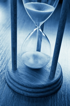sand timer: time concept with hourglass blue toned image