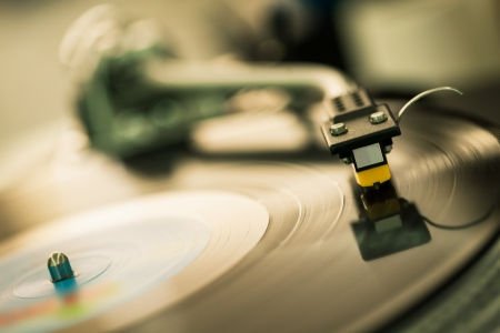 turntables: closeup shot of tonearm on the vinyl disc