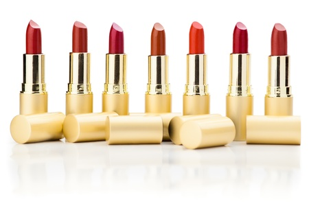 refelction: row of red lipsticks with refelction on white