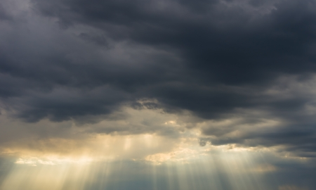 rain weather: dark storm clouds and sun rays