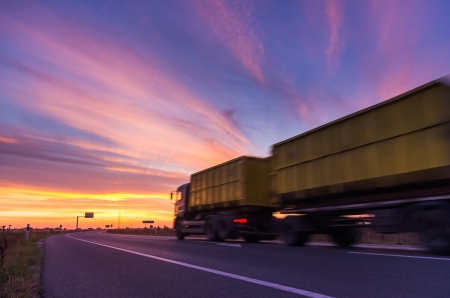 truck on road at sunset photo