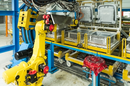 production facility: industrial robot on production line for foam