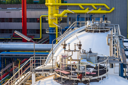 waste water: piping system and container in industrial plant Stock Photo
