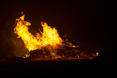 Dangerous high flames from the bonfire in Floradorp Amsterdam North in the Netherlands. Stockfoto