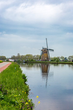 Windmill on a Dyke in the village of Nieuwe Wetering in The Netherlands