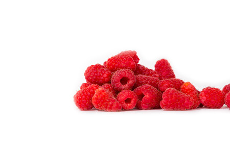 A highway exit lane with green grass on the sides. stack of raspberries against white background