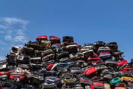 Stacked and wrecked cars at a junkyard in Amsterdam