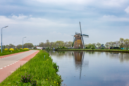 """Windmill """"the Googermolen"""" on the Ring canal in Nieuwe Wetering the Netherlands."""
