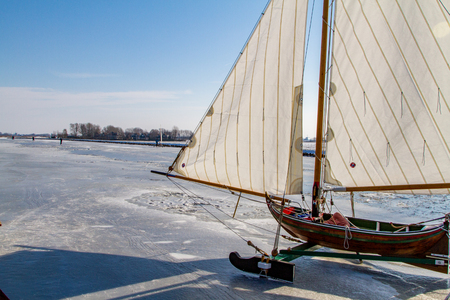 An icesailboot on the the river de Ringvaart in Holland