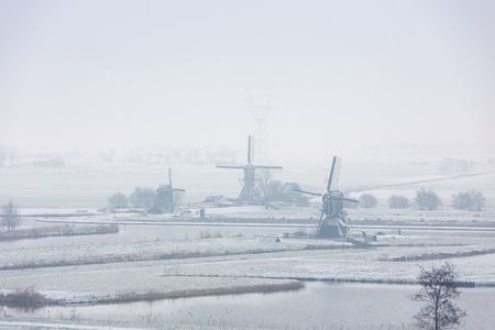 The Achthovense windmill, Doeshofwindmill and the Munnikkenwindmill on the river the Does in the Doespolder in the village of Leiderdorp in Netherlands.