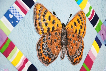 padding: Patchwork quilt with butterflies