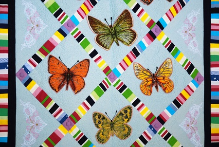 Patchwork quilt with butterflies