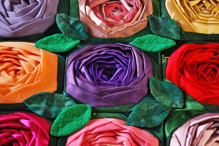 and craft materials: Colorful patchwork quilt with flowers. Handmade work Stock Photo