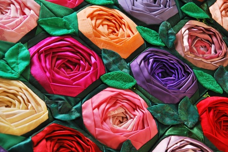 Colorful patchwork quilt with flowers. Handmade work photo