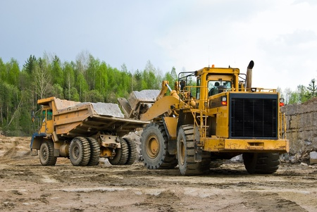 Excavation and dump vehicle in a granite quarry photo