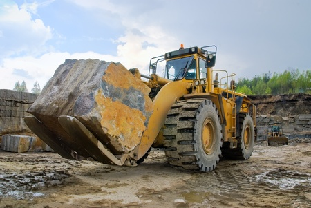 Excavation with a big stone  in a granite quarry Archivio Fotografico