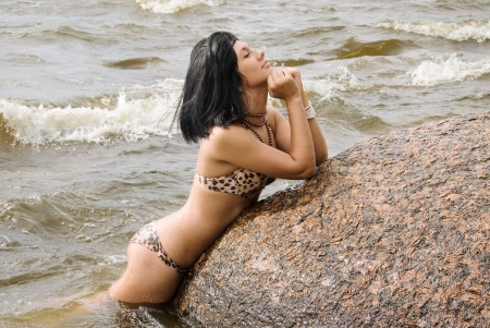 Young girl in bikini on coast of Gulf of Finland Stock Photo - 13702554