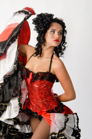 Young sexy brunette dancing in studio a french cancan  photo