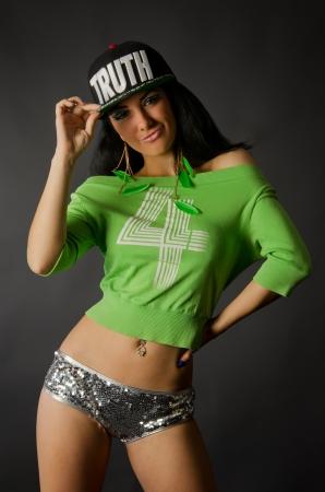 rnb: Young hip-hop dancer is posing in studio Stock Photo