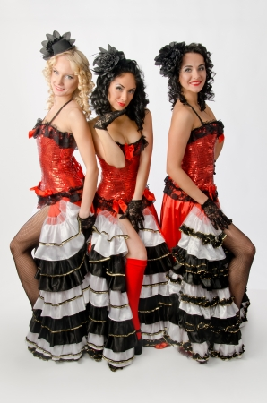 Three young girls dancing in studio a french cancan photo