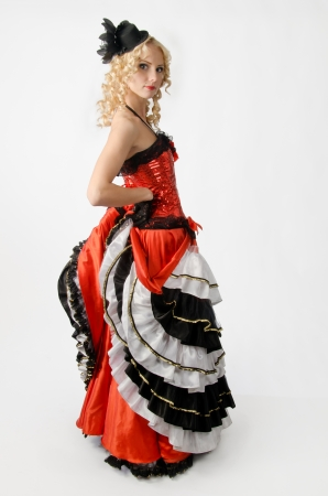 Young sexy blonde dancing in studio a french cancan photo