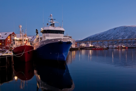 fishingboats: Fishingboats at the harbour in Tromso, Norway Stock Photo