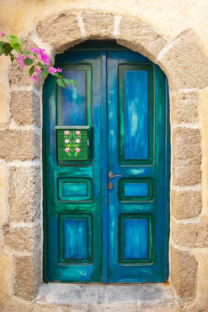 Wooden Blue Old Door of Greek Island photo