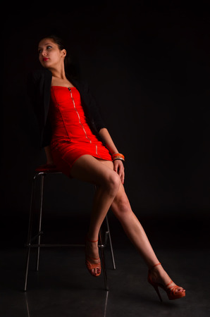 stylish brunette in a chair in the studio photo