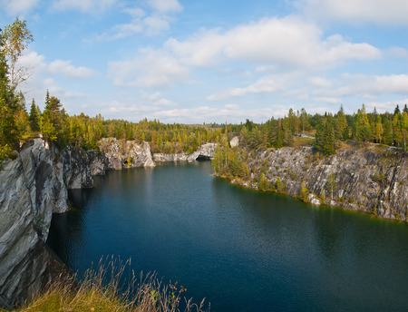 View of the forest lake in the rocks of marble photo