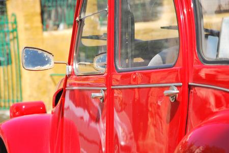 shiny car: Close up of a shiny red retro car