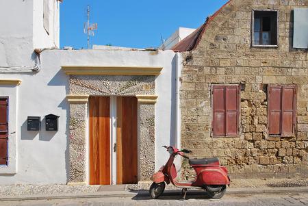 Mediterranean urban scene with motor bike, a very typical italian motorcycle