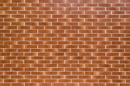 Brown brick wall background. Texture of smooth brickwork.