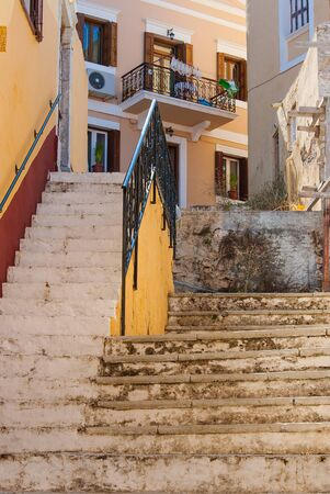 The old steps of a narrow staircase on Symi street