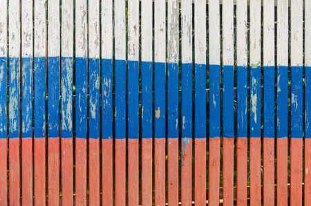 Wooden slats painted in the color of the Russian flag. Russian flag texture