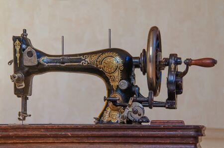 Black old vintage hand sewing machine.