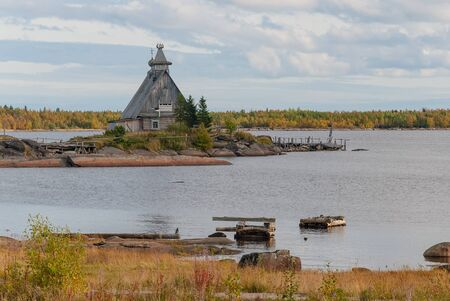 Russian landscape: a small church on the shore of the White Sea. Russian north, Karelia.