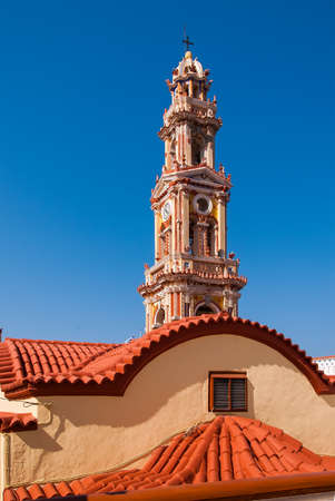 The bell-tower of the monastery Panormitis. Symi Island, Greece Editorial