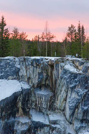 Ruskeala Mountain Park - Landmark of Russia. Marble mountain rock quarry winter landscape, Karelia
