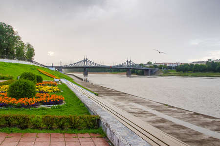 Tver, Russia - August, 2020: Volga river embankment and Old bridge in Tver