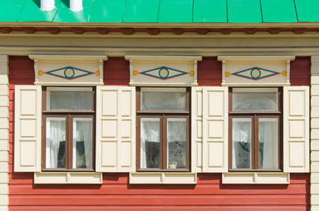 Beautiful wooden windows in an old house in the city of Kazan, Russia. Windows with carved platbands.
