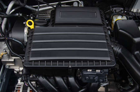 Photo of a new car engine covered with a plastic casing